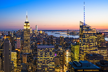 Manhattan skyline and Empire State Building at dusk, New York City, United States of America, North America