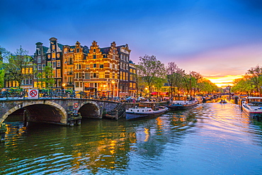 Traditional Dutch gabled houses and canal at dusk, Amsterdam, Netherlands, Europe