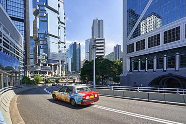 Red taxi in Central, Hong Kong Island, Hong Kong, China, Asia