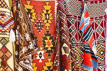 Colourful rugs and carpets for sale in Al Fahidi Historic Neighbourhood, Bur Dubai, Dubai, United Arab Emirates, Middle East