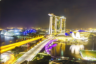 Busy roads leading to the Marina Bay Sands, Gardens by the Bay and ArtScience Museum at night, Singapore, Southeast Asia, Asia