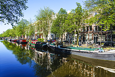 Old gabled buildings reflecting in a canal, Amsterdam, North Holland, The Netherlands, Europe