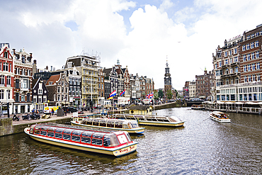 Tourist boats on Amstel River near Muntplein and Rokin, Amsterdam, North Holland, The Netherlands, Europe