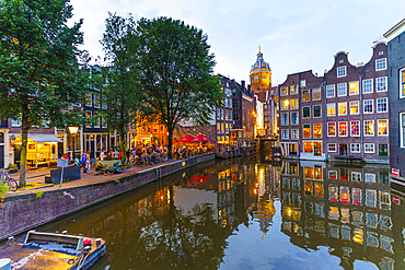 Restaurants by a canal at dusk, Oudezijds Kolk, Amsterdam, North Holland, The Netherlands, Europe