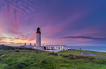 Mid-summer sunrise over The Mull of Galloway Lighthouse, Galloway, Scotland, United Kingdom, Europe