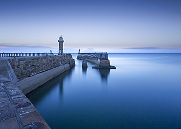 Whitby piers and lighthouses, shortly after sunset, Whitby, North Yorkshire, England, United Kingdom, Europe