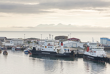 Mallaig harbour and distant Isle of Rum, Highlands, Scotland, United Kingdom, Europe