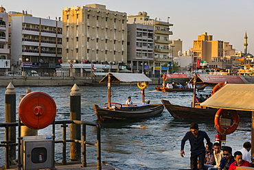 Water taxis carry passengers across Dubai Creek, Dubai, United Arab Emirates, Middle East