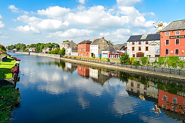 Homes line a canal in Kilkenny, County Kilkenny, Leinster, Republic of Ireland, Europe