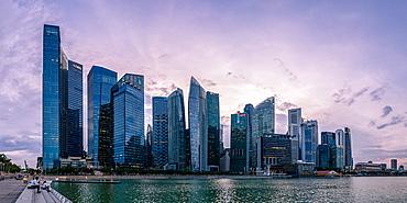 Skyscrapes line Marina Bay at dusk, Singapore, Southeast Asia, Asia