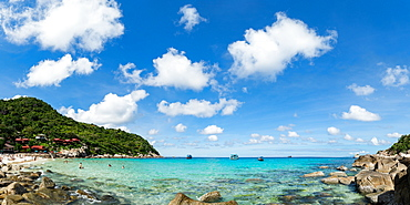 Toursits enjoy the clear water and sun at a beach on the Thai island of Koh Tao, Thailand, Southeast Asia, Asia