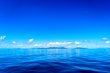 Blue sky and ocean with islands in the background, Queensland, Australia, Pacific