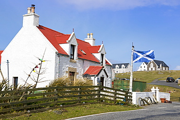 House with Saltire Flag, Isle of Eriskay, Outer Hebrides, Scotland, United Kingdom, Europe