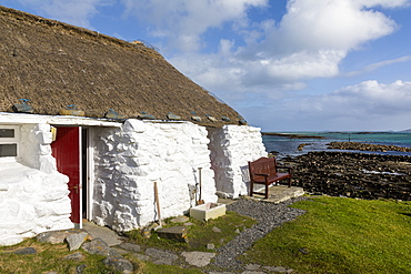 Thatched cottage and hostel, Isle of Berneray, North Uist, Outer Hebrides, Scotland, United Kingdom, Europe