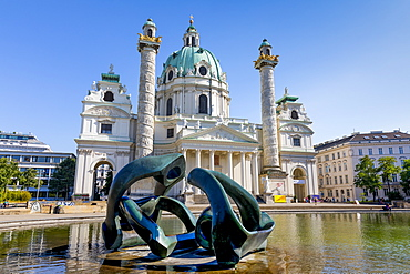 Karlskirche (St. Charles Church), with Hill Arches sculpture by Henry Moore in foreground, Karlsplatz, Vienna, Austria, Europe