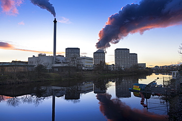 Industrial chimney smoke and smoke from scrap yard tyre fire, River Clyde, Glasgow, Scotland, United Kingdom, Europe