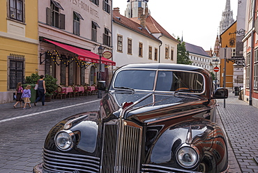 Antique car and Pest-Buda Restaurant near the Fisherman's Bastion, Budapest, Hungary, Europe