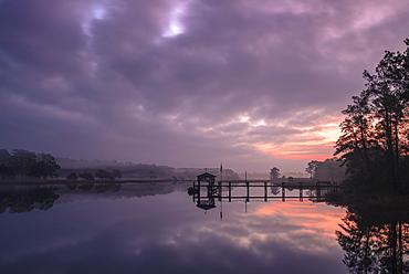 Sunrise and dock on intracoastal waterway, Calabash, North Carolina, United States of America, North America