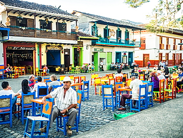 Patrons relax at cafe tables, Parque Principal, Jardin, Antioquia, Colombia, South America