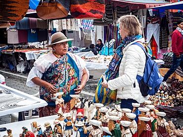 Tourist shopping at market, Plaza de los Ponchos, Otavalo, Ecuador, South America