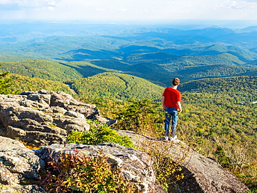 Boy looks at the view from the peak of Grandfather Mountain, Blue Ridge Mountains, Appalachia, North Carolina, United States of America, North America