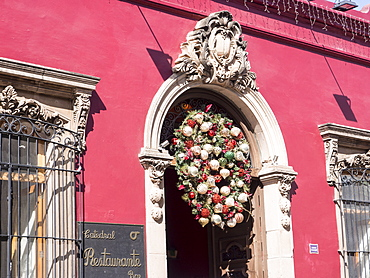 Red building with Christmas decorations, Catedral Restaurante, Oaxaca, Mexico, North America