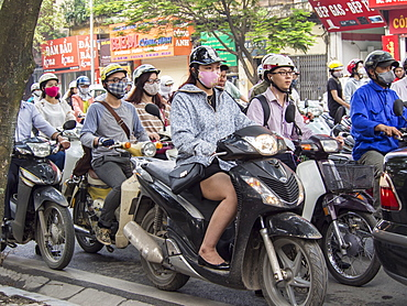 Motorbike traffic and facemasks, Hanoi, Vietnam, Indochina, Southeast Asia, Asia