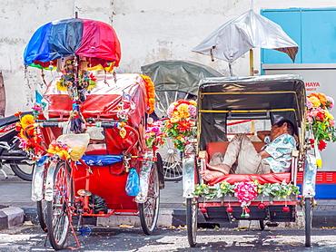 Resting rickshaw driver, Georgetown, Penang, Malaysia, Southeast Asia, Asia
