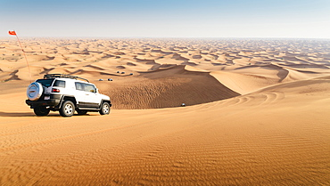 Off road vehicle on sand dunes near Dubai in the United Arab Emirates, Middle East