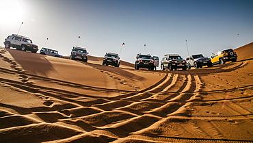 Off road vehicles on sand dunes near Dubai, United Arab Emirates, Middle East