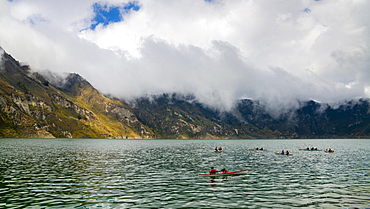 Kayaks at Quilotoa, a water-filled caldera and the most western volcano in the Ecuadorian Andes, Ecuador, South America