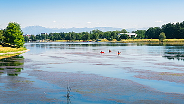 Kayaks at Idroscalo, a large park just outside the city centre on a summer's day, with Alps visible, Milan, Lombardy, Italy, Europe