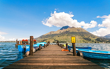 A pier and boat on Lago San Pablo, at the base of Volcan Imbabura, close to the famous market town of Otovalo, Ecuador, South America
