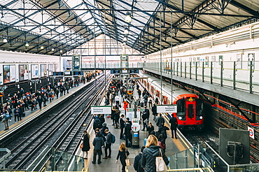 Commuters at Earl's Court Tube station on the District and Circle line platforms, Earls Court, London, England, United Kingdom, Europe