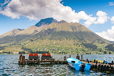 A pier and boat at the base of Volcan Imbabura and Lago San Pablo, close to the famous market town of Otovalo, Ecuador, South America