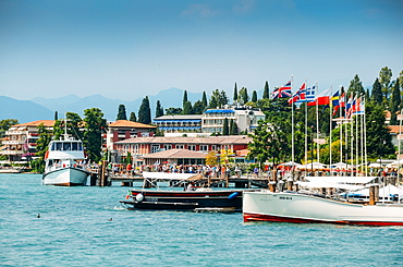Busy marina and ferry terminal at Sirmione, Lake Garda, Lombardy, Italian Lakes, Italy, Europe