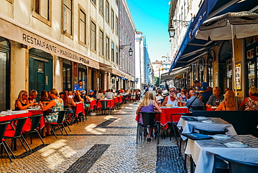 Busy outdoor terrace Portuguese restaurants at Rua da Prata catering to tourists, Lisbon, Portugal, Europe
