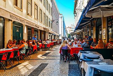 Busy outdoor terrace Portuguese restaurants at Rua da Prata catering to tourists, Lisbon, Portugal, Europe - 1243-329