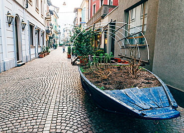 A boat filled with plants on a street in Stresa, Piedmont, Italy, Europe
