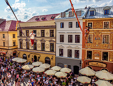 Musicians highlining over the Market Square, Old Town, Urban Highline Festival, Lublin, Lublin Voivodeship, Poland
