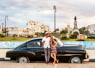 Cuban Couple with Vintage Chevrolet Car, La Habana Vieja, Havana, La Habana Province, Cuba, West Indies, Caribbean, Central America