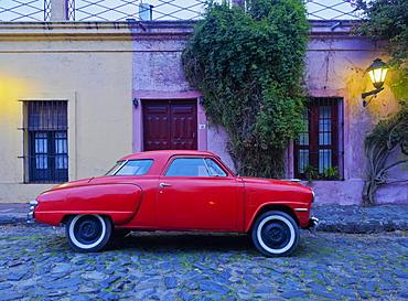 Vintage Studebaker car on a cobblestone lane of the historic quarter, Colonia del Sacramento, Colonia Department, Uruguay, South America