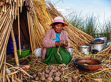 Native Uro Lady cooking, Uros Floating Islands, Lake Titicaca, Puno Region, Peru, South America