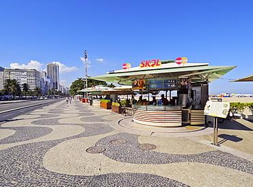 Portuguese wave pattern pavement and beach bar at Copacabana, Rio de Janeiro, Brazil, South America