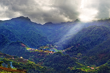 Elevated view of a remote village and tree covered hills and mountains near Sao Vicente, Madeira, Portugal, Atlantic, Europe - 1246-37