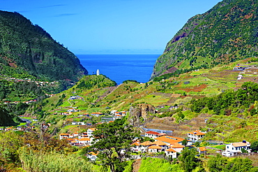 A distant view of Tower Chapel, Capela de Nossa Senhora de Fatima, looking towards Sao Vicente and the Atlantic Ocean, Madeira, Portugal, Atlantic, Europe