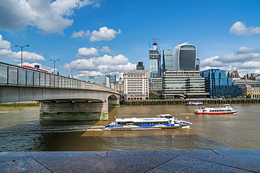 Two public boats race down the River Thames, London England, United Kingdom, Europe