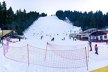 People sledging and enjoying the snow, Borovets Ski Resort, Bulgaria, Europe