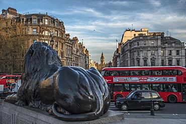 Landseer lion statue and double decker bus, London icons at Trafalgar Square, London, England, United Kingdom, Europe