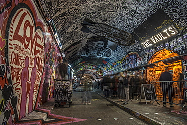 Graffiti Artists and people awaiting a show at The Vaults in the Leake Street Tunnel in London, England, United Kingdom, Europe